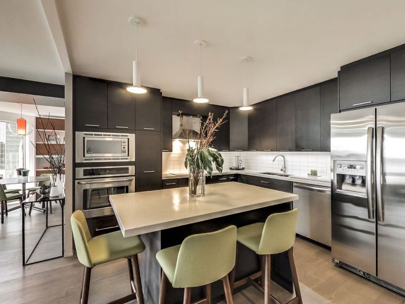 401 Queens Quay W 502 kitchen island with pendant lighting makes for a great eating area and work space