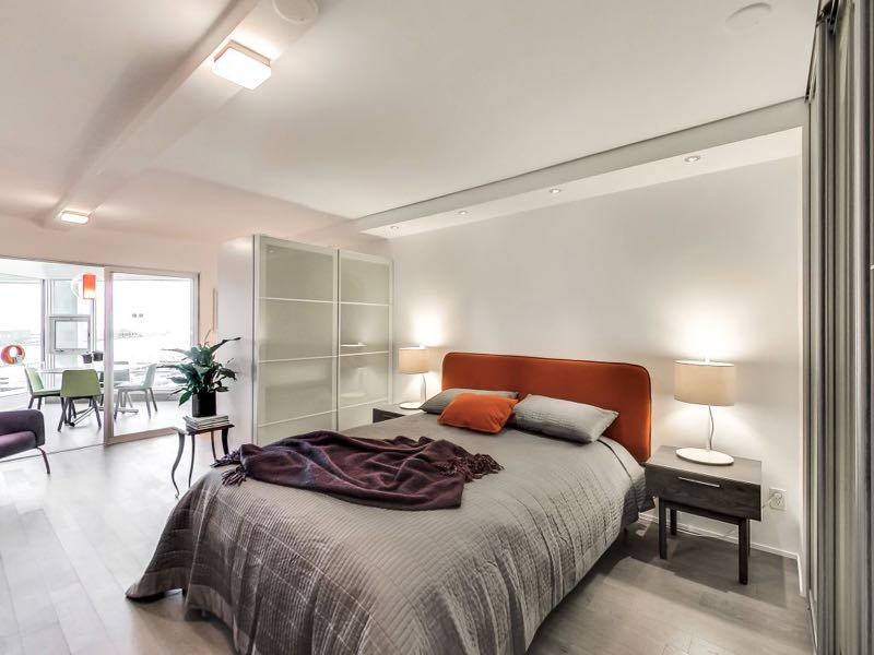 401 queens quay w 502 master bedroom has modern lighting and good storage