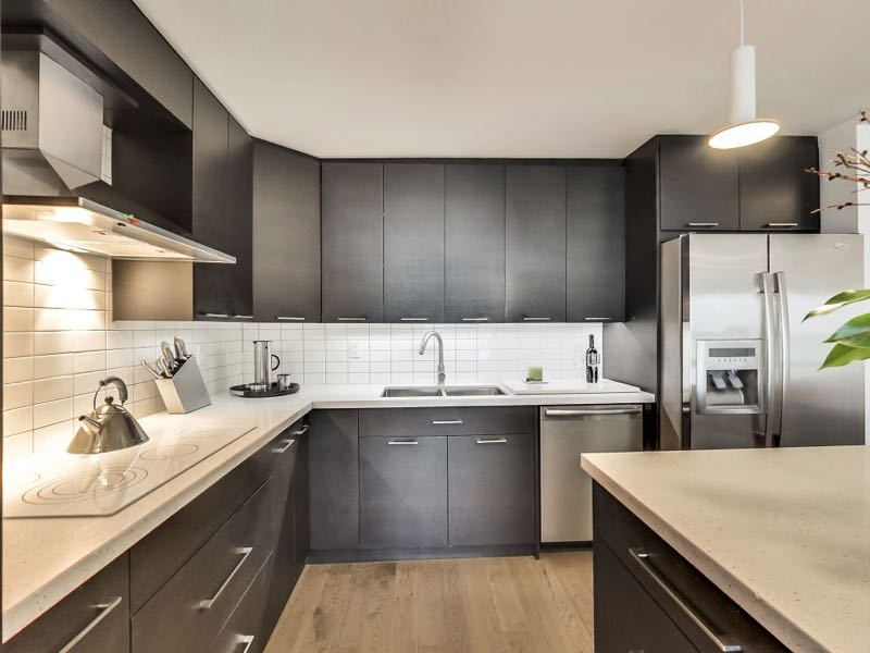 401 queens quay w kitchen with stone counters and upgraded appliances