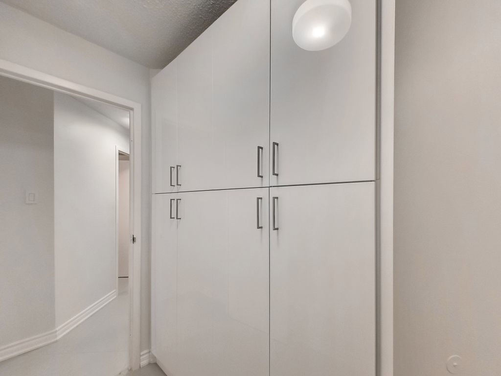 401 Queens Quay 503 laundry room has built in storage