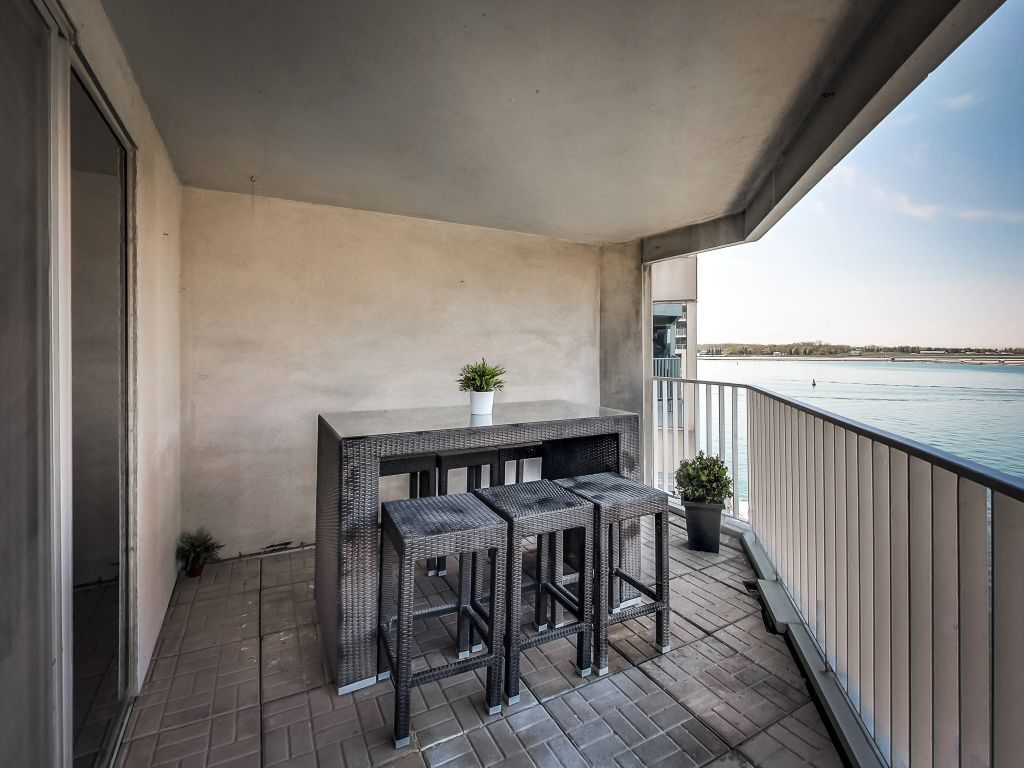 401 Queens Quay W 503 has a large open balcony right on the water