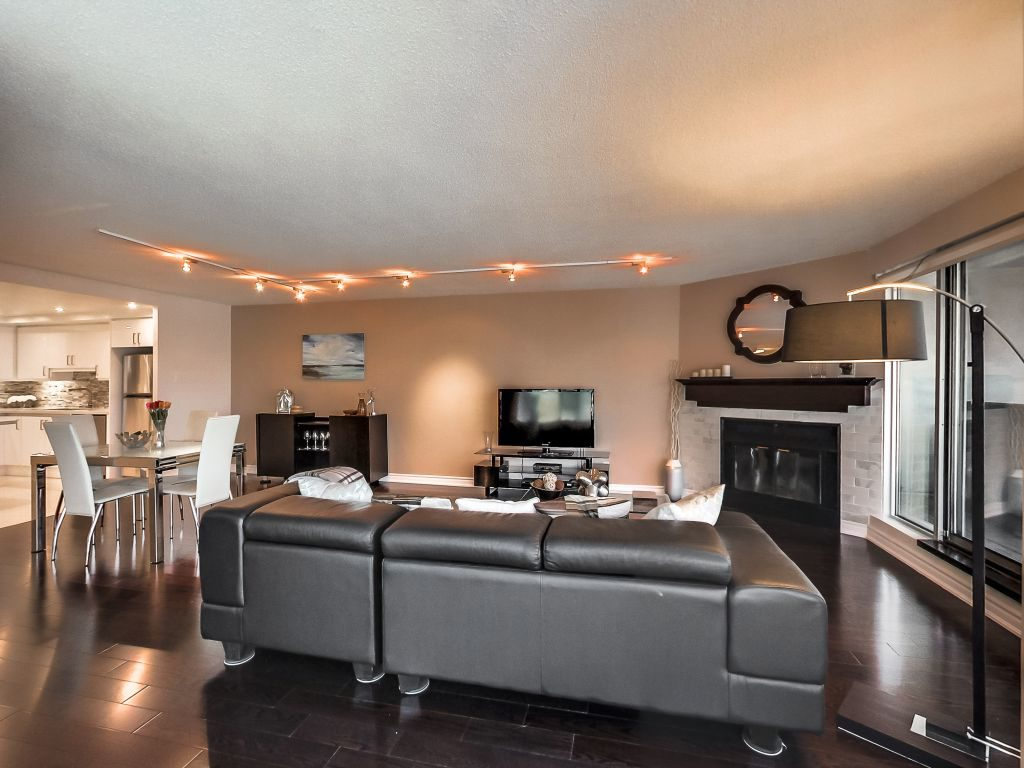 401 Queens Quay W 503 living room and dining room wood burning fireplace and walkout to balcony