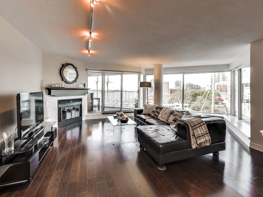401 Queens Quay W 503 living room has wood burning fireplace