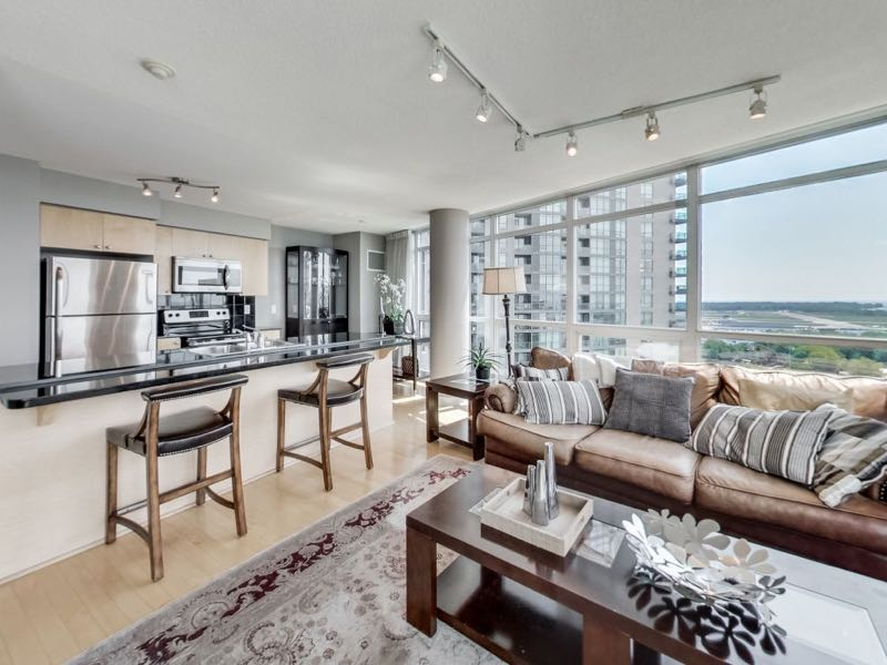 231 Fort York Blvd 1603 living area adjoining breakfast bar view a wall of windows