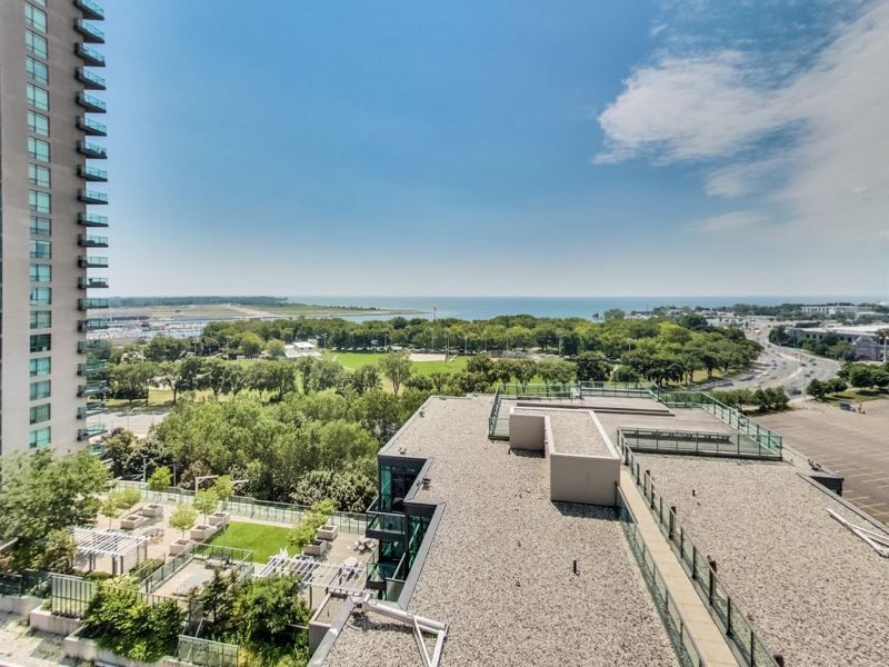 231 Fort York Blvd 1603 view overlooking secondary rooftop deck greenspace and Lake Ontario