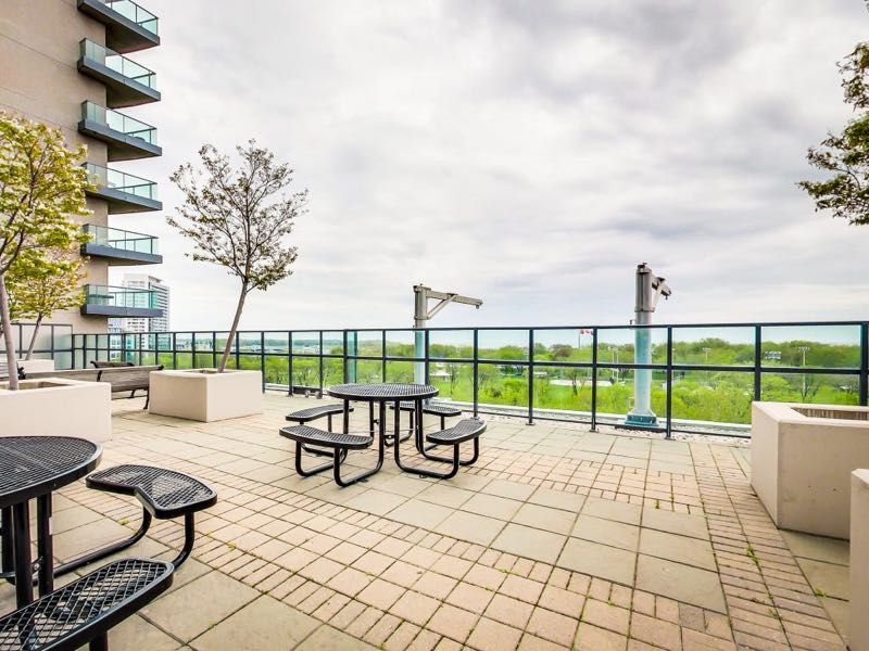 231 Fort York Blvd seating areas on rooftop deck beside BBQs